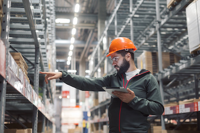Worker Managing Warehouse Inventory